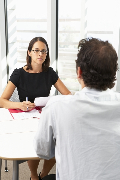 5345437-businesswoman-interviewing-male-candidate-for-job